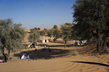 Base camp with Bedu mess tent and individual dome tents for people to sleep in