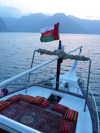 Flag of Oman and Musandam moutains