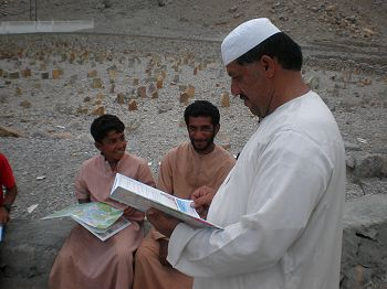 Local children & adults with educational books.