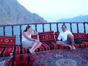 Relaxing on the live-aboard dhow's top deck after a day's survey work